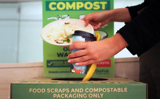 throwing food scraps and compostable packaging in the biopak bin