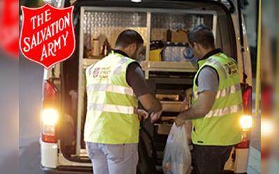 Salvation Army food truck with two employees