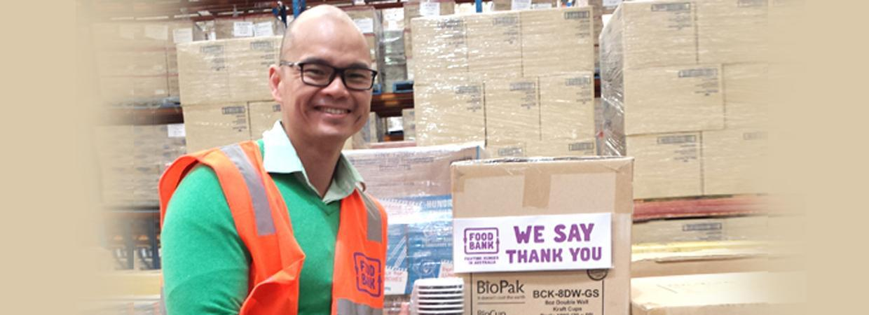Man receiving BioCups in the Foodbank Warehouse
