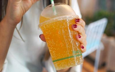 drinking from bioplastic compostable cup lifestyle