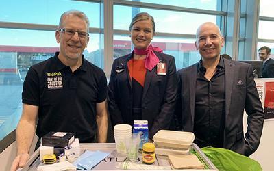 Gary Smith and Richard Fine with Qantas stewardess