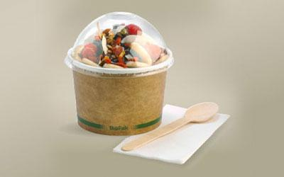Kraft Paper BioBowls with dome lid paired with wooden spoon and napkin