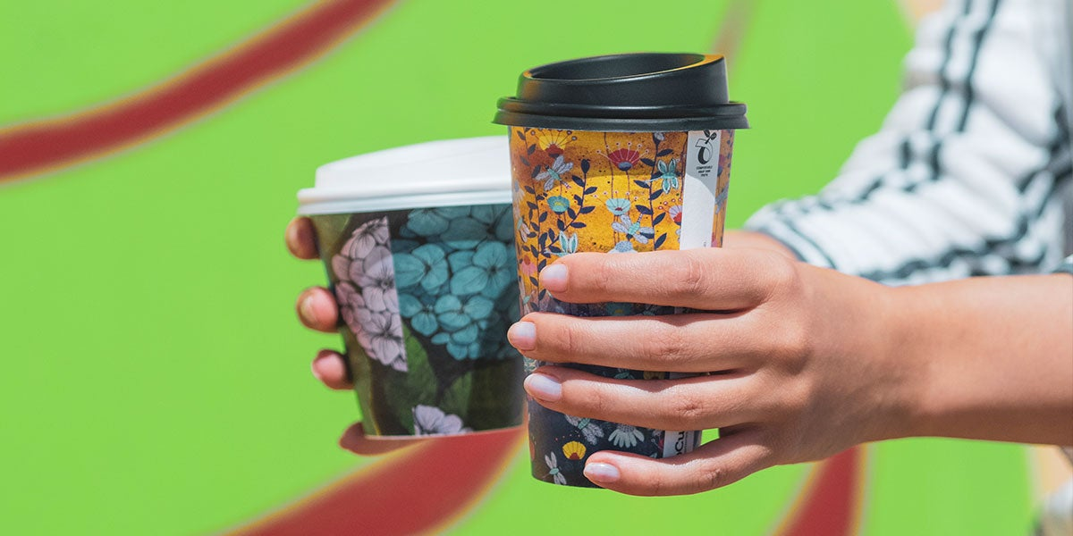 hands holding coffee cups