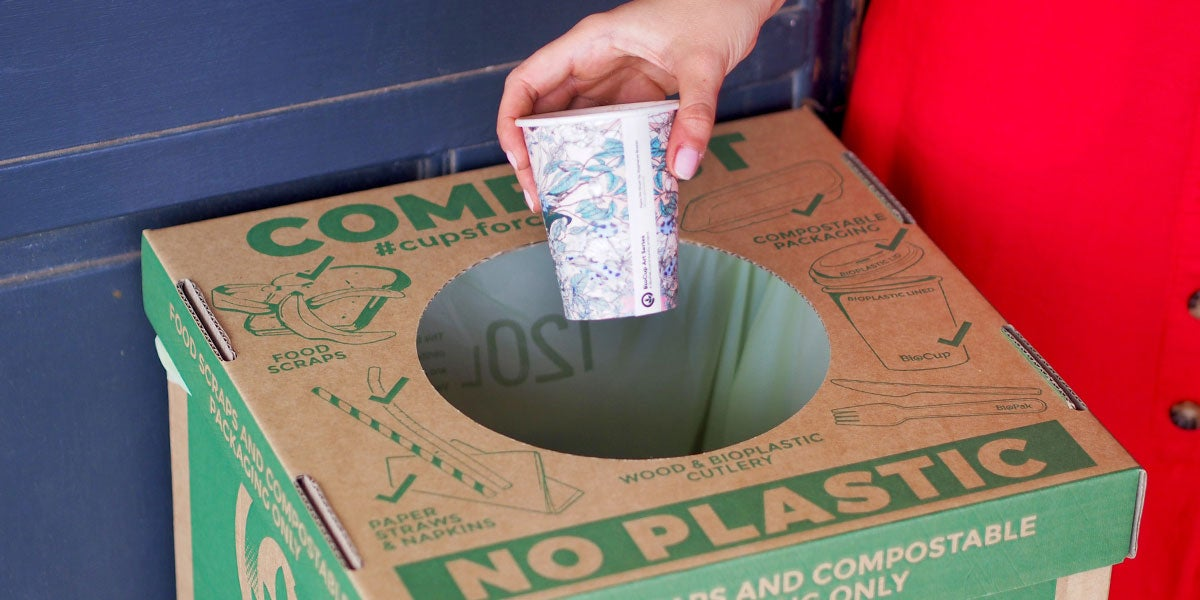 throwing paper cup into the BioPak compost bin