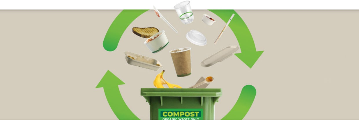 Compostable BioPak Products and food scraps falling into a compost bin.