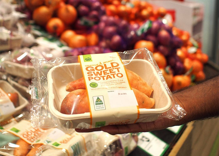 person holding a sweet potato packaging